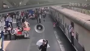شاهد.. لحظة إنقاذ طفلة من الموت تحت عجلات قطار